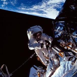 NASA astronaut Story Musgrave (left) near the top of the Hubble Space Telescope during the final EVA of STS-61. Credit: NASA