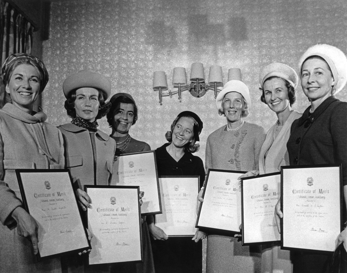 Group shot of wives taken in 1963 at a Ladies Auxiliary event in Washington, D.C. From left are: Carpenter, Cooper, Glenn, Grissom, Schirra, Shepard and Slayton. Credit: NASA via Retro Space Images