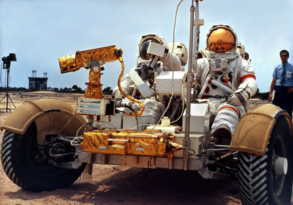 David Scott, commander, at right, and James Irwin, lunar module pilot, at left. train with the Lunar Roving Vehicle (LRV). Credit: NASA via Retro Space Images