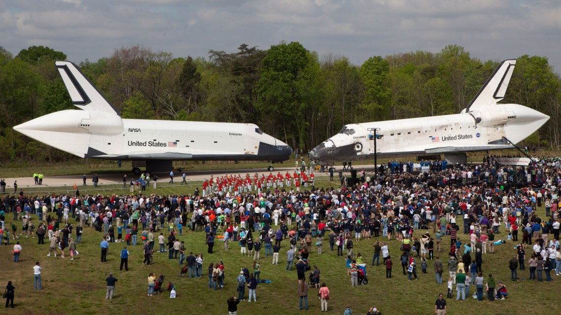 Space Shuttles Enterprise (left) and Discovery (right) sit nose to nose during the deed transfer ceremony at the Smithsonian's Steven F. Udvar-Hazy Center, Thursday on April 19, 2012. Photo: Smithsonian