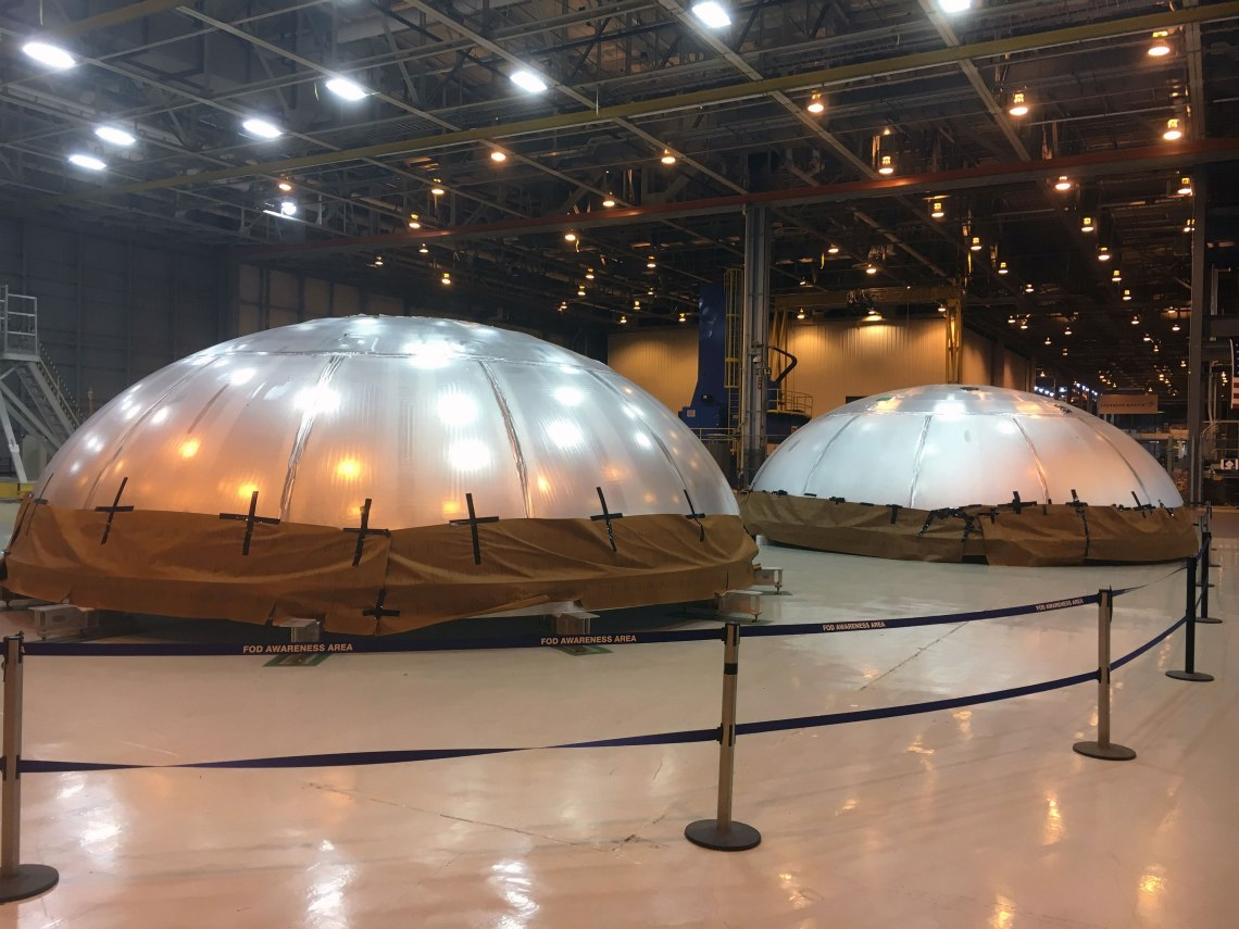 Two fuel tank domes were recently finished for the SLS rocket. One is a qualification article and the other is the actual flight article for the first mission (EM-1) set to launch in 2018. Credit: Chase Clark