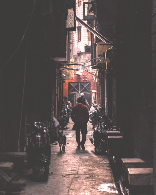 man waking down narrow street
