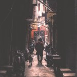 man waking down narrow street