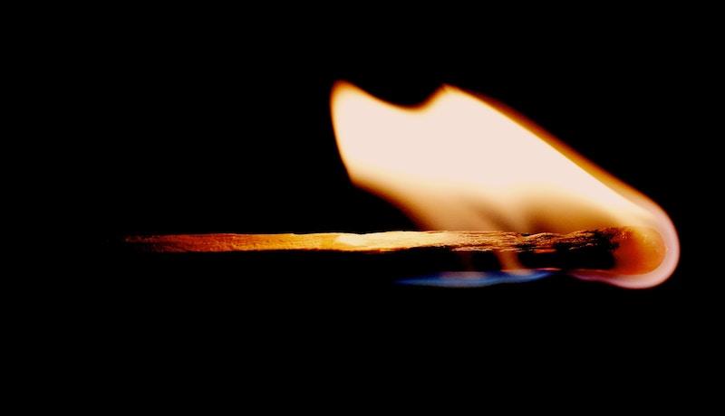 a lit matchstick