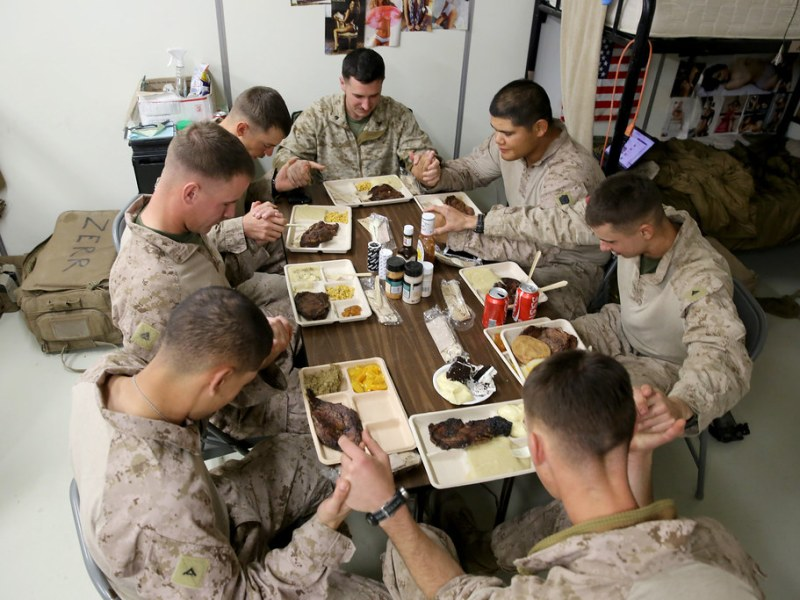 Marines giving thanks before a meal