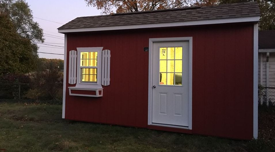 Small shed with lights on