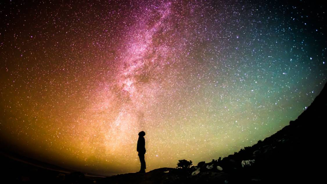 picture of a man looking at the universe