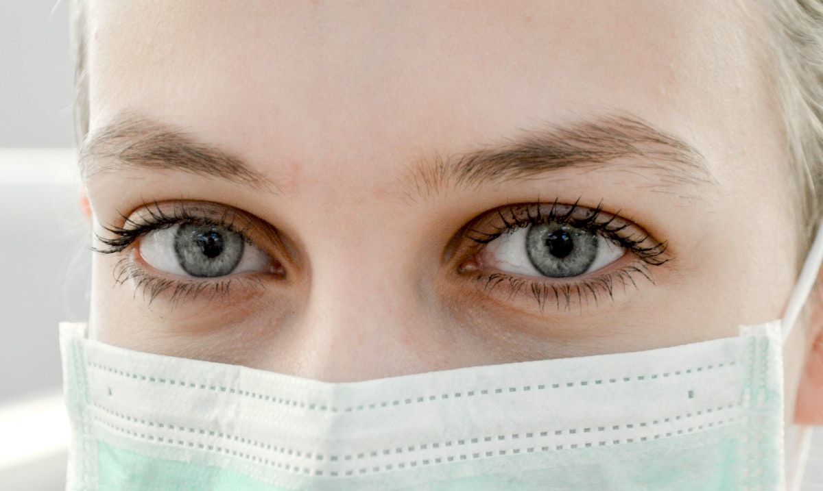pic of woman's eyes with facemask