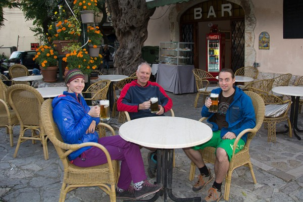 Natalie Berry, Mark Glaister and Paul Phillips relaxing with a beer after a day's crag research at S'estret on Mallorca during the work for this new guidebook