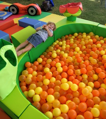 Laying outside the ball pit