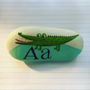 Alligator painted on a rock
