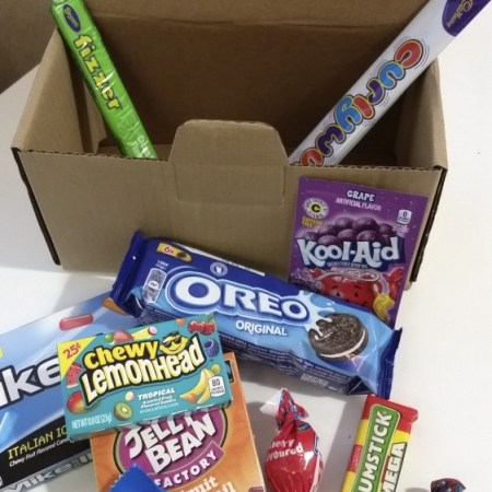 Image of the contents of The Student Survival Box. selection of traditional and retro sweets
