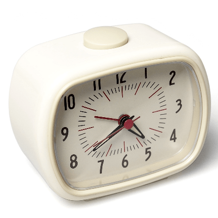 Image of a retro ivory alarm clock. Battery Powered. Compact.