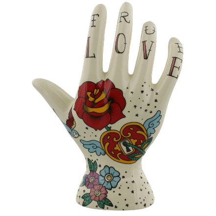 Image of the Rose Tattoo Palmistry hand. A ceramic tattoo design ornament.