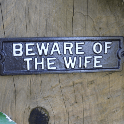 Image of beware of the wife cast iron sign