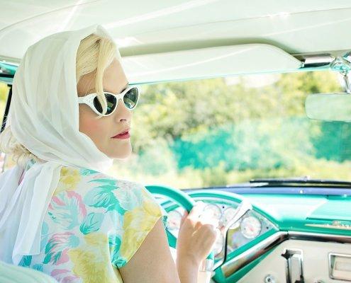 Image of a lady in a vintage car 1950s