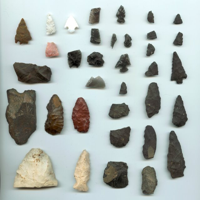 Indian arrowheads for sale and indian artifacts for sale displayed in a case