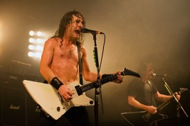 Joel of Airbourne on stage at Portsmouth Pyramids, November 2013