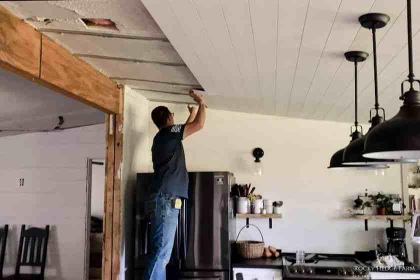 wood plank ceiling idea over popcorn