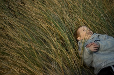 a child in the tall grass