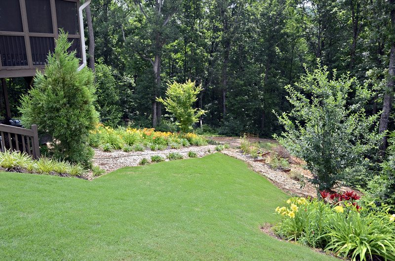 How to stop flooding with these landscape drainage solutions for Yard drainage slope