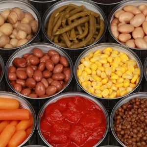 a-group-of-opened-cans-of-food-containing-fruits-vegetables-and-legumes