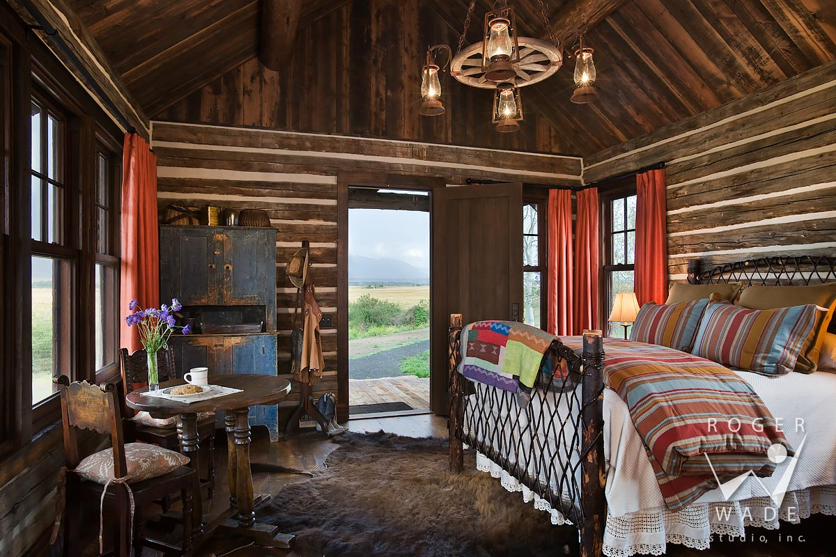 log cabin photography, restored cabin toward bed, looking out door to ranch view, mcallister, mt