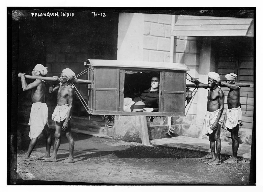 Four Indians Carrying Palanquin