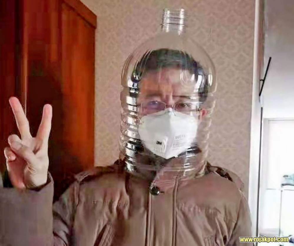 Man wearing N95 respirator and water bottle at Wuhan Jinyintan Hospital