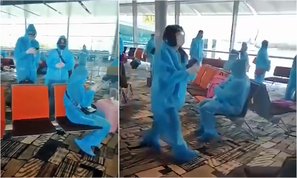 Changi Airport Blue PPE suits screenshot