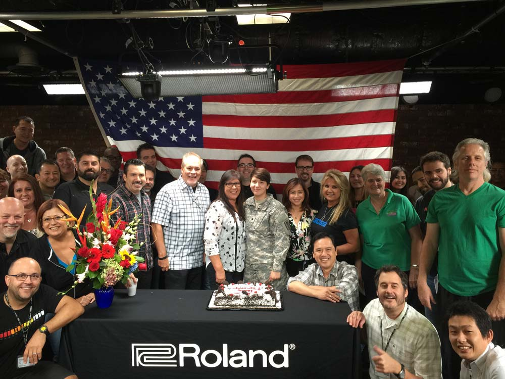 Roland U.S. President and CEO Jay Wanamaker, fellow Roland U.S. Officers, Directors and employees pose with Mary Ann and Kim for a homecoming we will never forget. THANK YOU for your service Kim, and welcome home.