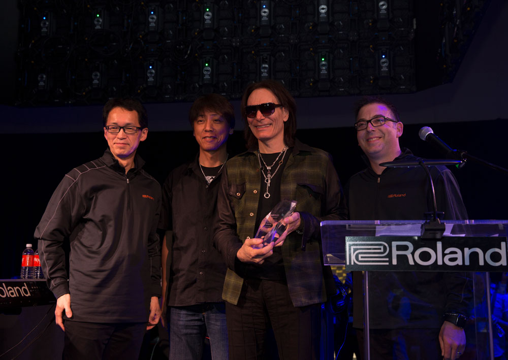 Roland Corporation CEO and Representative Director Jun-ichi Miki, BOSS Corporation President Yoshi Ikegami, Steve Vai, and Roland Corporation Vice President of Global Key Influencers Brian Alli (left to right).