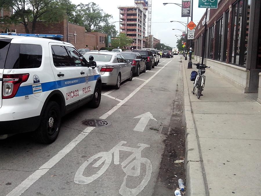 Bike lane, inside parked cars