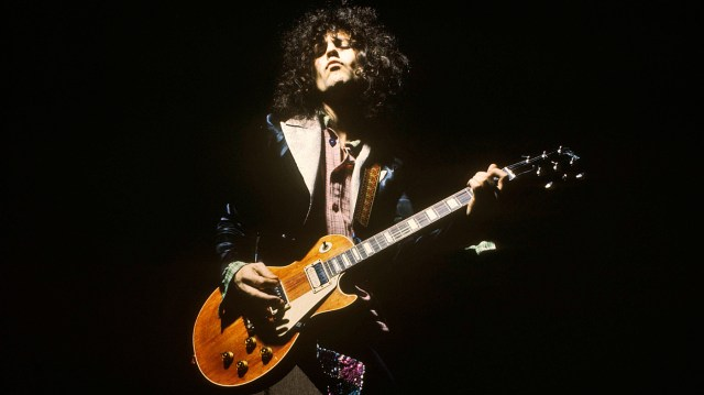 UNITED KINGDOM - JANUARY 01: Photo of T REX and Marc BOLAN; performing live onstage, playing Gibson Les Paul guitar (Photo by Estate Of Keith Morris/Redferns)