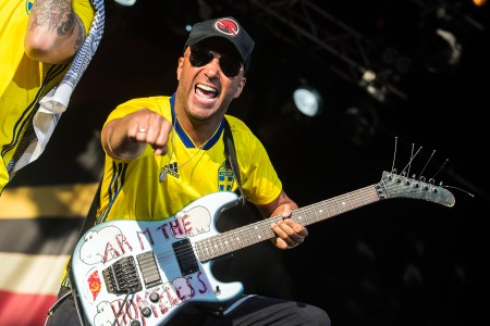 watch injured tom morello recruit fan for rage against the machine song rolling stone