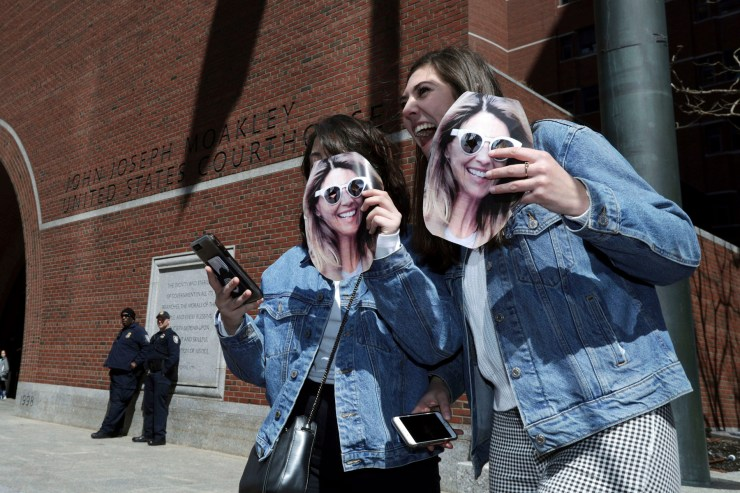 Two people hold cutout photos of actress Lori Loughlin outside federal court in Boston, where Loughlin is scheduled to face charges in a nationwide college admissions bribery scandalCollege Admissions-Bribery, Boston, USA - 03 Apr 2019