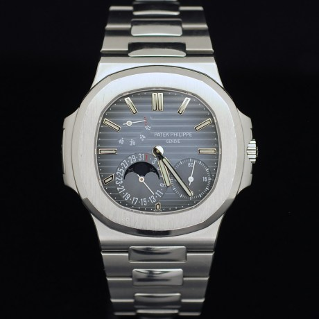 PATEK PHILIPPE NAUTILUS REF. 5712 BOX & PAPERS