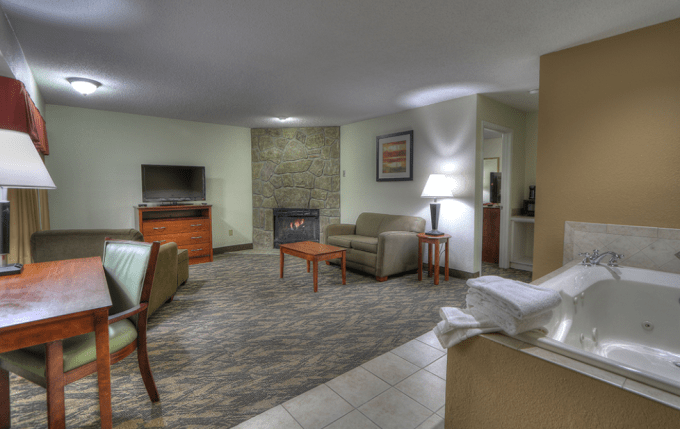 A Hotel Room With Jacuzzi and Fireplace in Crossroads Inn & Suites in Gatlinburg