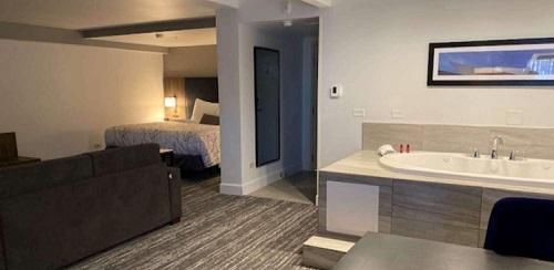 Hot tub room in Best Western Premier Denver East Hotel