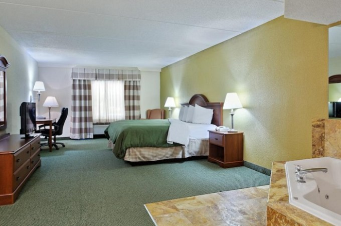 Suite with Whirlpool in the room in Country Inn & Suites by Radisson, Charlotte University Place, NC Hotel