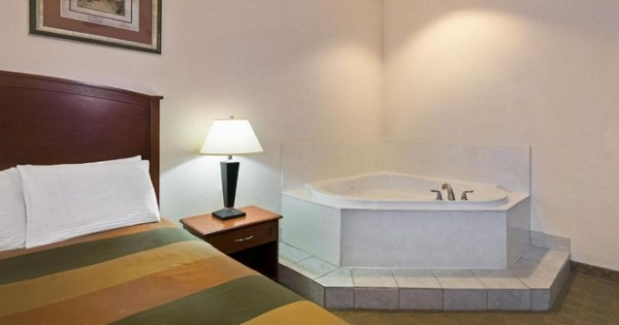 Room with a whirlpool tub in Super 8 by Wyndham Austin-Airport South, TX