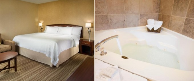 Suite with a whirlpool tub in the room in Courtyard Seattle North - Lynnwood Everett, WA