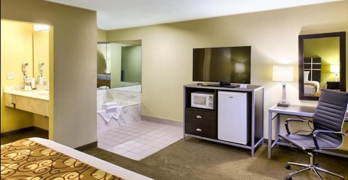 Suite with a private whirlpool tub in the bedroom in Country Hearth Inn of Knightdale, near Raleigh, NC