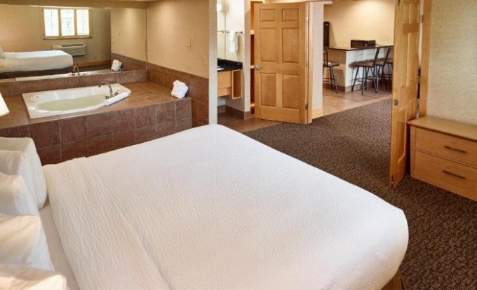 Suite with a hot tub in the room in LivINN Hotel Minneapolis North - Fridley, MN