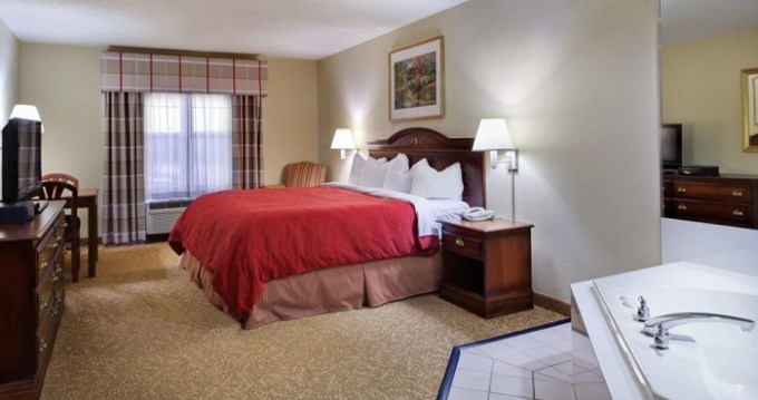 Jacuzzi suite in Country Inn & Suites by Radisson, Louisville South, KY Hotel