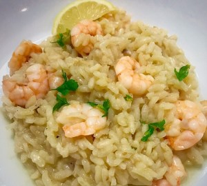 Lemon and prawn risotto garnished iwth fresh parsley