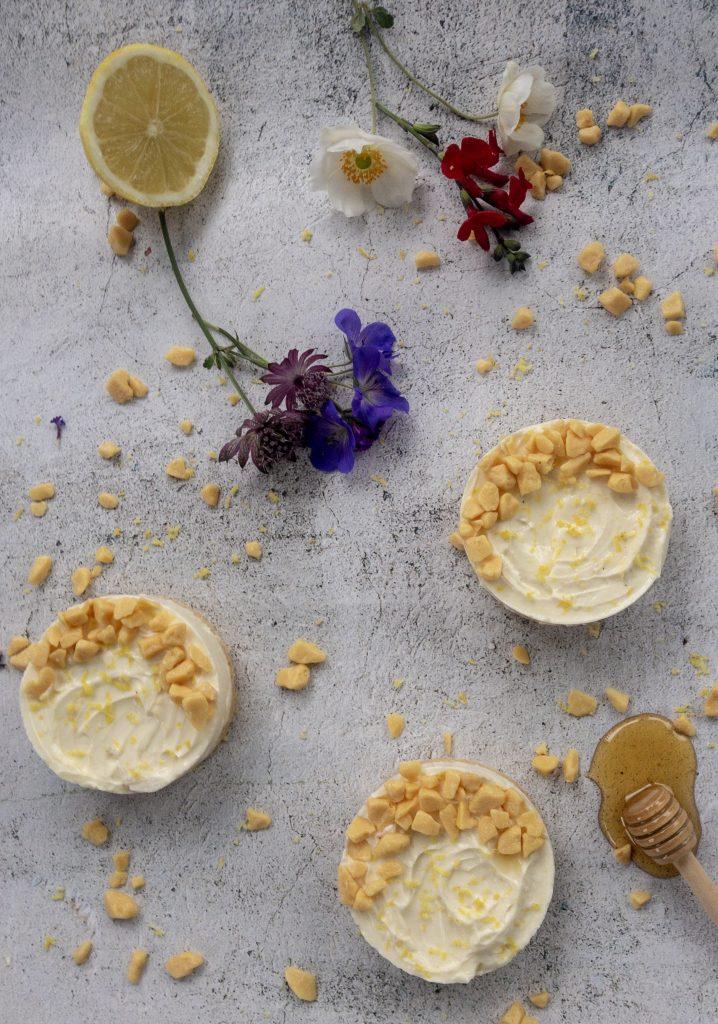Lemon and honey mini cheesecakes flatlay view
