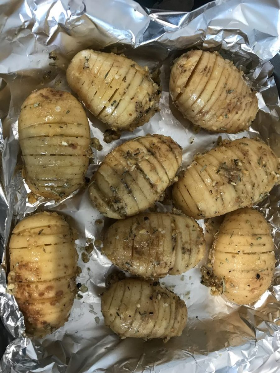 Process shot of rosemary hassleback potatoes