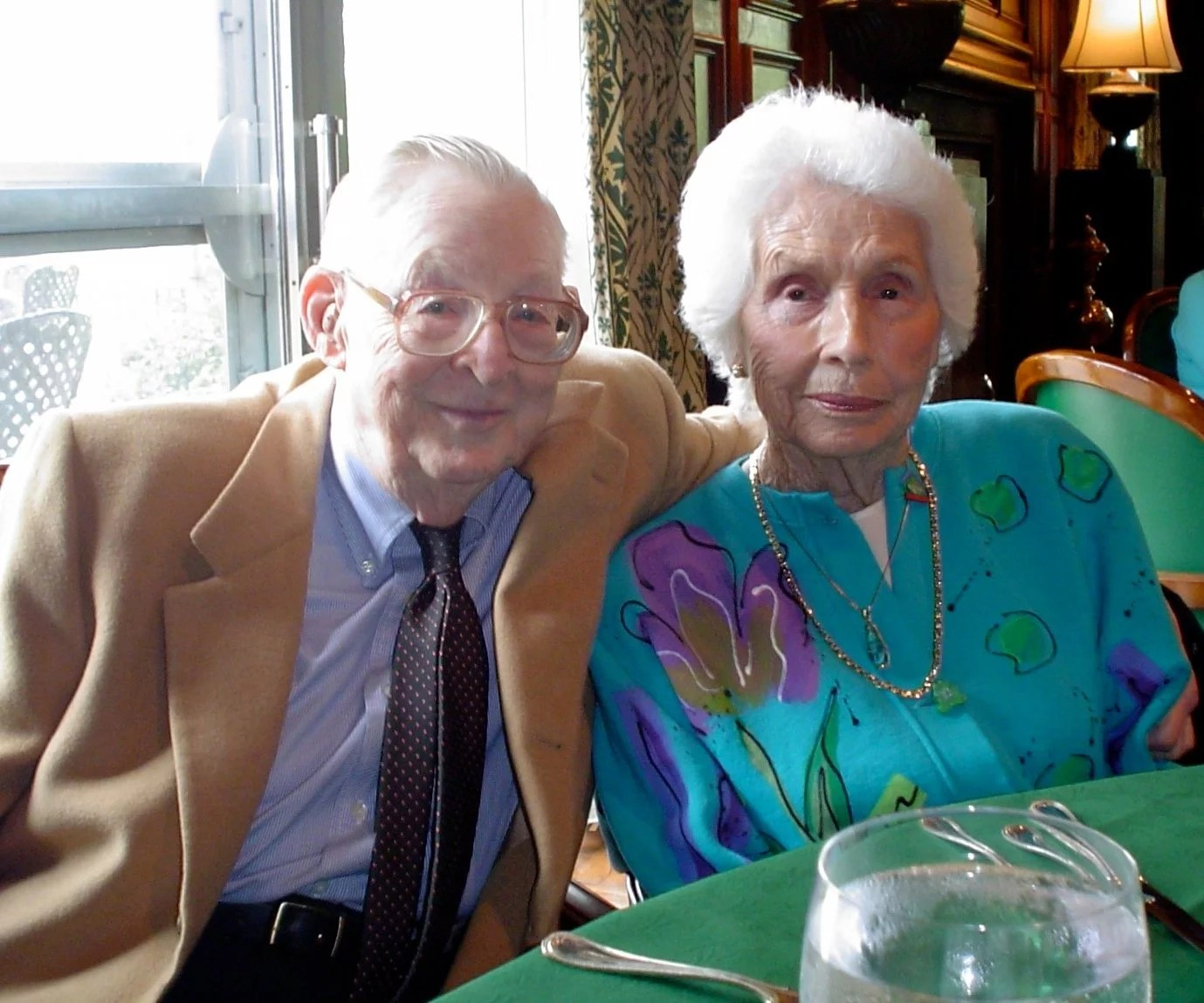 Well dressed elderly couple at dinner