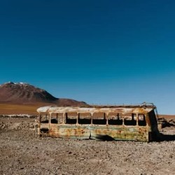 Abandoned bus in the desert sun